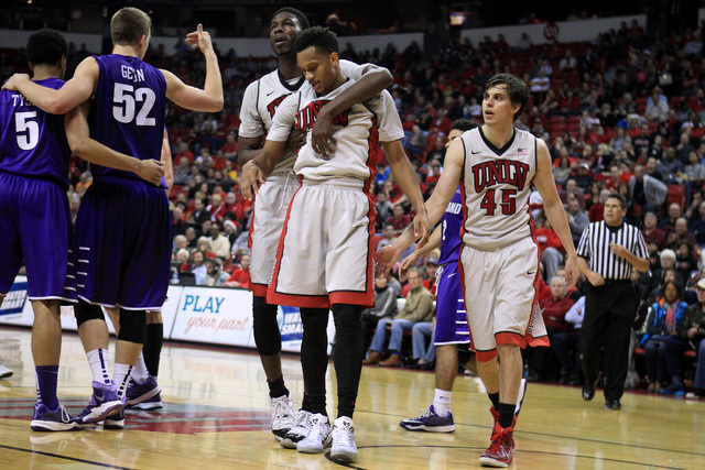 UNLV forward Goodluck Okonoboh hugs UNLV guard Rashad Vaughn after picking him up off the floor during the second half of their game against Portland Wednesday, Dec. 17, 2014 at the Thomas & Mack  ...