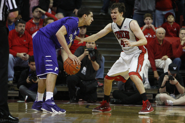 UNLV guard Cody Doolin guards Portland guard Bryce Pressley during overtime of their game Wednesday, Dec. 17, 2014 at the Thomas & Mack Center. UNLV won 75-73 in overtime. (Sam Morris/Las Vegas Re ...