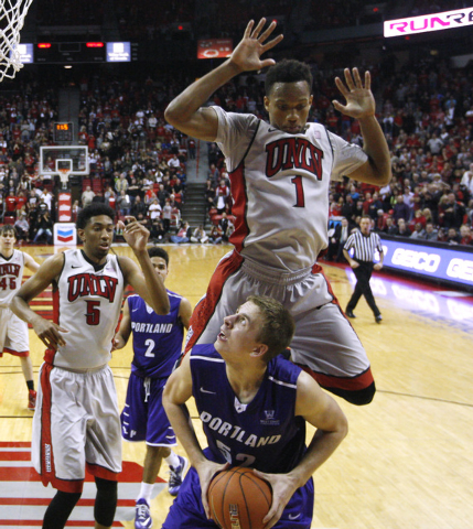 UNLV guard Rashad Vaughn fouls Portland forward Volodymyr Gerun during the second half of their game Wednesday, Dec. 17, 2014, at the Thomas & Mack Center. UNLV won 75-73 in overtime. (Sam Morris/ ...