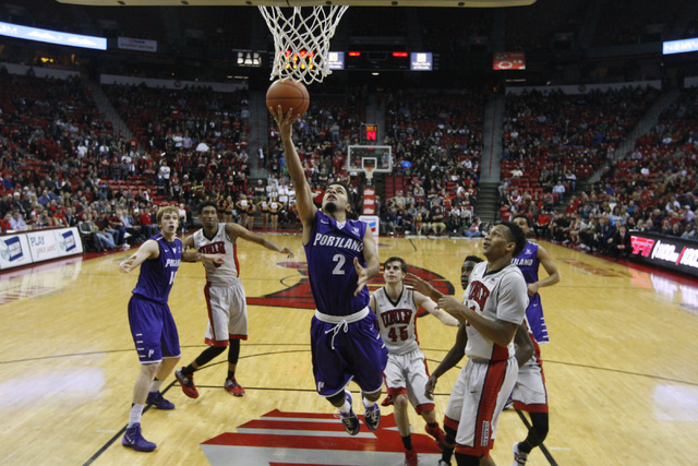 Portland guard Alex Wintering drives to the basket past UNLV guard Rashad Vaughn  during the second half of their game Wednesday, Dec. 17, 2014 at the Thomas & Mack Center. UNLV won 75-73 in overt ...