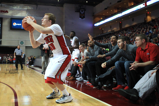 The bench reacts as UNLV guard Dantley Walker gets set for a 3-point shot against Saint Katherine during their game Friday, Dec. 5, 2014 at the Orleans Arena. UNLV won the game 113-53. (Sam Morris ...