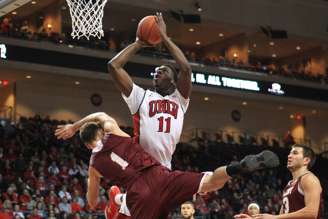 UNLV forward Goodluck Okonoboh shoots and is fouled by Saint Katherine guard Aragad Abramian during their game Friday, Dec. 5, 2014 at the Orleans Arena. UNLV won the game 113-53. (Sam Morris/Las  ...