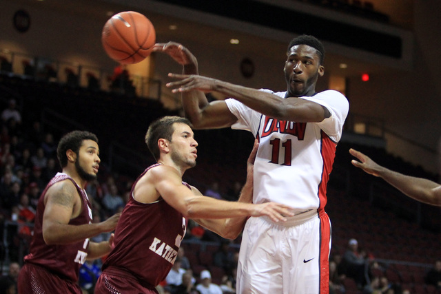 UNLV forward Goodluck Okonoboh dishes off a pass past Saint Katherine forward John Der during their game Friday, Dec. 5, 2014 at the Orleans Arena. UNLV won the game 113-53. (Sam Morris/Las Vegas  ...