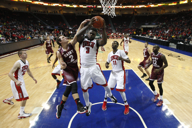 UNLV guard Jordan Cornish grabs a rebound away from Saint Katherine guard Curtis Tavares during their game Friday, Dec. 5, 2014 at the Orleans Arena. UNLV won the game 113-53. (Sam Morris/Las Vega ...