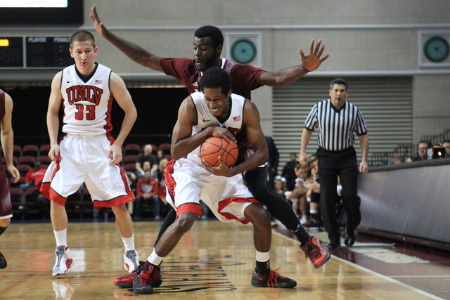 UNLV guard Barry Cheaney protects the ball from Saint Katherine guard D'vaughn Mann during their game Friday, Dec. 5, 2014 at the Orleans Arena. UNLV won the game 113-53. (Sam Morris/Las Vegas Rev ...