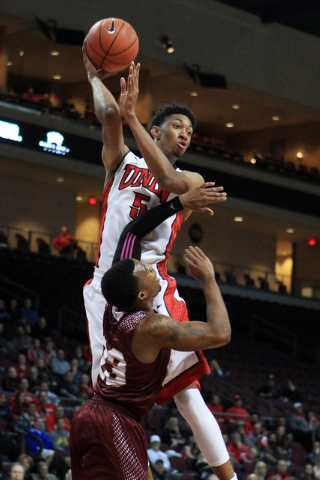 UNLV forward Christian Wood passes over the top of Saint Katherine guard Jebari Robinson during their game Friday, Dec. 5, 2014 at the Orleans Arena. UNLV won the game 113-53. (Sam Morris/Las Vega ...