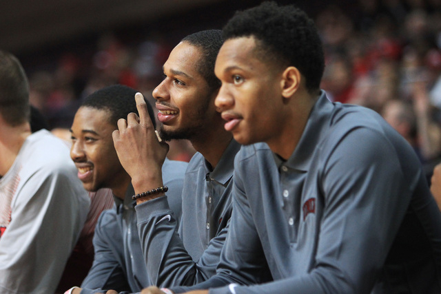 From left, redshirt Daquan Cook, and injured Jelan Kendrick and Rashad Vaughn watch their teammates take on Saint Katherine during their game Friday, Dec. 5, 2014 at the Orleans Arena. UNLV won th ...