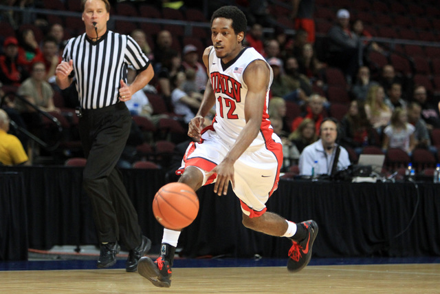 UNLV guard Barry Cheaney takes the ball up court against Saint Katherine during their game Friday, Dec. 5, 2014 at the Orleans Arena. UNLV won the game 113-53. (Sam Morris/Las Vegas Review-Journal)