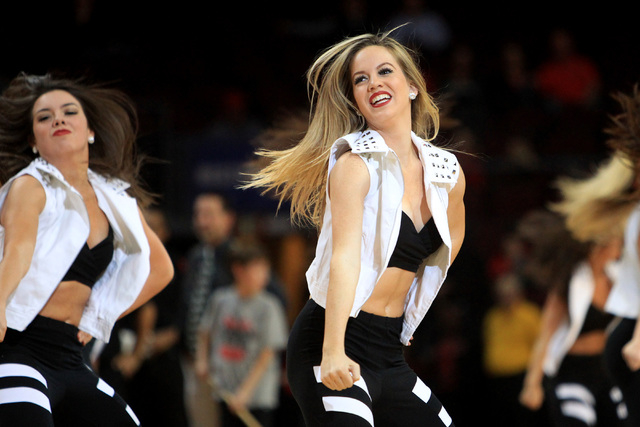 Members of the UNLV dance team perform during their game against Saint Katherine Friday, Dec. 5, 2014 at the Orleans Arena. UNLV won the game 113-53. (Sam Morris/Las Vegas Review-Journal)