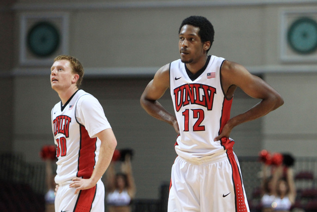 UNLV guard Dantley Walker and UNLV guard Barry Cheaney stand a mid court for a free throw during their game against Saint Katherine Friday, Dec. 5, 2014 at the Orleans Arena. UNLV won the game 113 ...