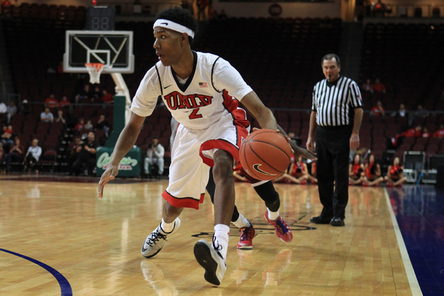 UNLV guard Patrick McCaw looks for a teammate during their game against Saint Katherine Friday, Dec. 5, 2014 at the Orleans Arena. UNLV won the game 113-53. (Sam Morris/Las Vegas Review-Journal)