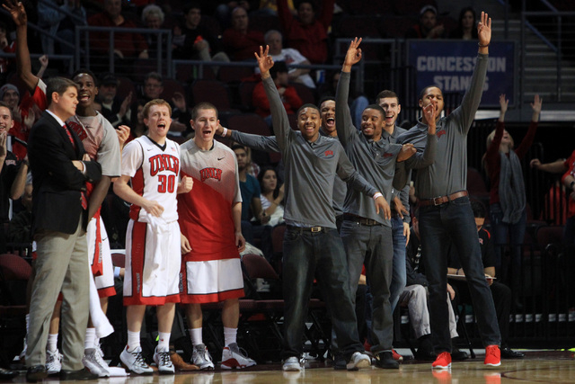 The UNLV bench celebrates a successful 3-point shot against Saint Katherine during their game Friday, Dec. 5, 2014 at the Orleans Arena. UNLV won the game 113-53. (Sam Morris/Las Vegas Review-Journal)