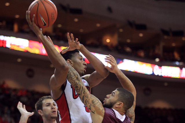 UNLV forward Christian Wood is guarded by Saint Katherine guard Dante Miller during their game Friday, Dec. 5, 2014 at the Orleans Arena. UNLV won the game 113-53. (Sam Morris/Las Vegas Review-Jou ...