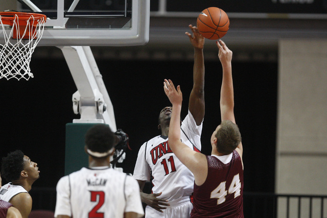 UNLV forward Goodluck Okonoboh blocks a shot by Saint Katherine center Jimmy Roethier during their game Friday, Dec. 5, 2014 at the Orleans Arena. UNLV won the game 113-53. (Sam Morris/Las Vegas R ...