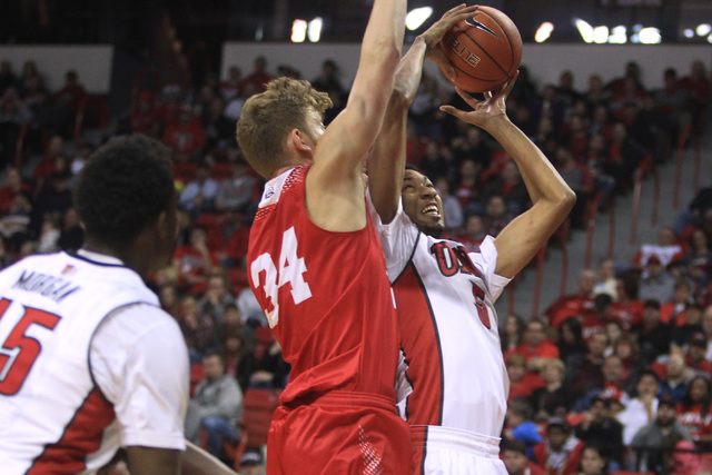 UNLV forward Christian Wood puts up a shot while being defended by Southern Utah forward Cal Hanks during their game Saturday, Dec. 27, 2014 at the Thomas & Mack Center. UNLV won the game 79-45. ( ...