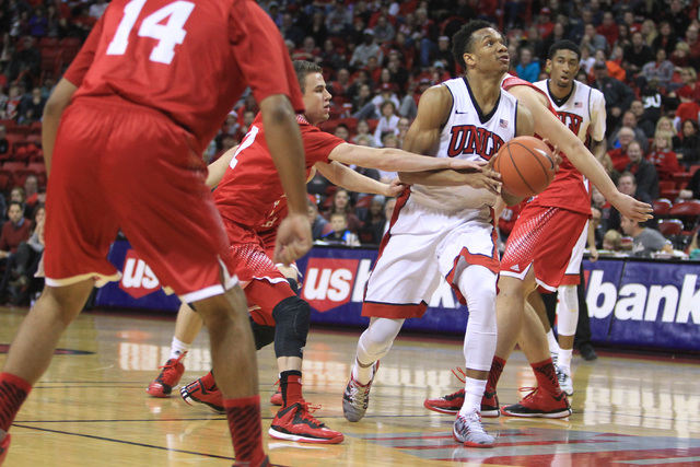 UNLV guard Rashad Vaughn is fouled by Southern Utah guard Austin Waddoups while driving to the basket during their game Saturday, Dec. 27, 2014 at the Thomas & Mack Center. UNLV won the game 79-45 ...