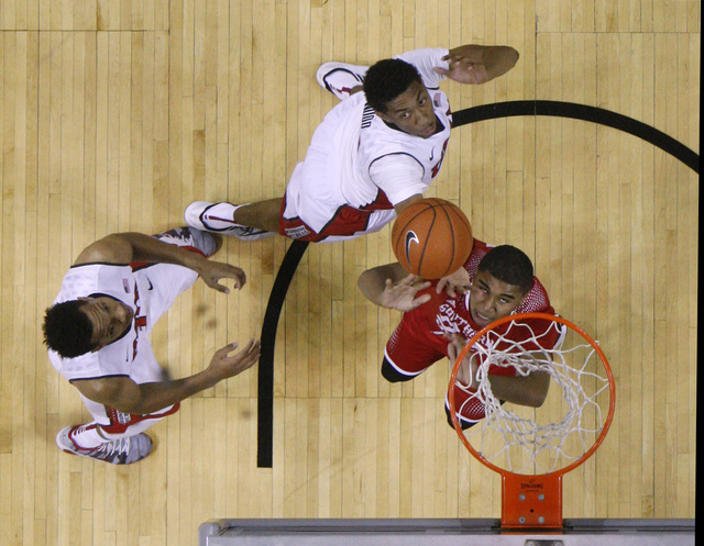 UNLV forward Christian Wood blocks a shot by Southern Utah forward Sherron Wilson during their game Saturday, Dec. 27, 2014 at the Thomas & Mack Center. UNLV won the game 79-45. (Sam Morris/Las Ve ...