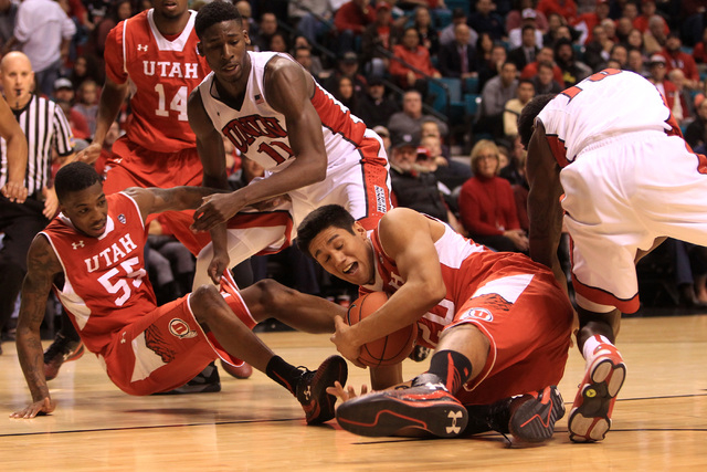 Utah forward Chris Reyes grabs a loose ball from UNLV forward Goodluck Okonoboh andUNLV forward Dwayne Morgan during their MGM Grand Showcase game Saturday, Dec. 20, 2014. (Sam Morris/Las Vegas Re ...