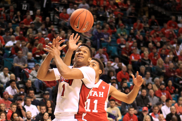 UNLV guard Rashad Vaughn loses his grip on the ball while being defended by Utah guard Brandon Taylor during their MGM Grand Showcase game Saturday, Dec. 20, 2014. (Sam Morris/Las Vegas Review-Jou ...