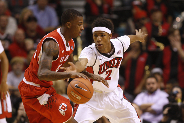UNLV guard Patrick McCaw defends Utah guard Delon Wright during their MGM Grand Showcase game Saturday, Dec. 20, 2014. (Sam Morris/Las Vegas Review-Journal)