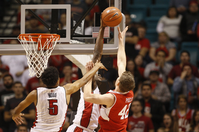 UNLV forward Goodluck Okonoboh blocks a shot by Utah forward Jakon Poeltl during their MGM Grand Showcase game Saturday, Dec. 20, 2014. (Sam Morris/Las Vegas Review-Journal)
