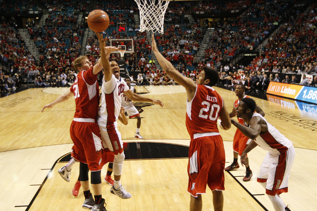 UNLV guard Rashad Vaughn drives past Utah center Dallin Bachynski for a basket during their MGM Grand Showcase game Saturday, Dec. 20, 2014. (Sam Morris/Las Vegas Review-Journal)