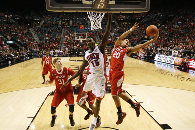 Utah forward Chris Reyes grabs a rebound from UNLV forward Dwayne Morgan  during their MGM Grand Showcase game Saturday, Dec. 20, 2014. (Sam Morris/Las Vegas Review-Journal)