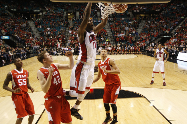 UNLV forward Goodluck Okonoboh dunks on Utah during their MGM Grand Showcase game Saturday, Dec. 20, 2014. (Sam Morris/Las Vegas Review-Journal)