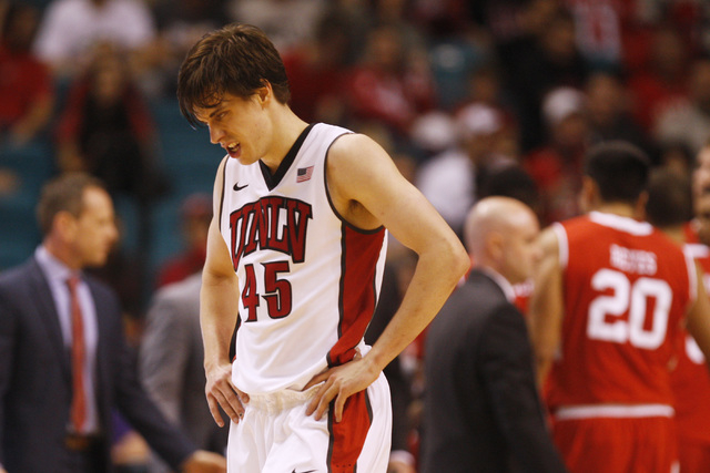 UNLV guard Cody Doolin heads to the bench for a timeout during their MGM Grand Showcase game against Utah Saturday, Dec. 20, 2014. Utah won 59-46. (Sam Morris/Las Vegas Review-Journal)