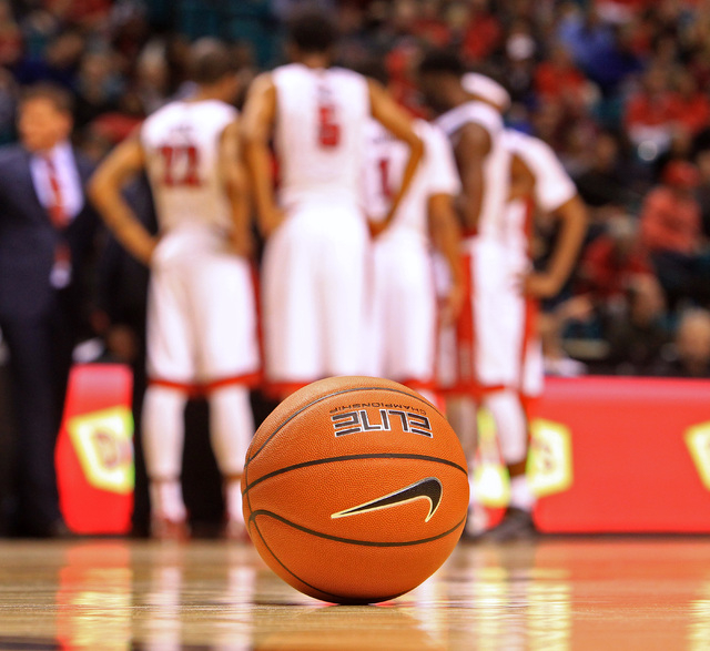 A ball sits on the court as UNLV takes a time out during their MGM Grand Showcase game against Utah Saturday, Dec. 20, 2014. Utah won 59-46. (Sam Morris/Las Vegas Review-Journal)
