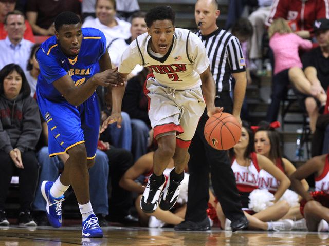 UNLV guard Patrick McCaw gets a rebound away from Morehead forward Anthony Elechi during the Rebels home opener Friday, Nov. 14, 2014 at the Thomas & Mack Center. (Sam Morris/Las Vegas Review-Journal)
