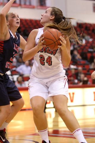 UNLV women's basketball senior forward Alana Cesarz (24) looks to shoot in front of Dixie State center Taylor Mann in the second half of an exhibition game at the Cox Pavilion Monday, Nov. 10, 201 ...