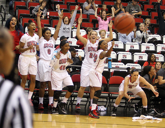 UNLV women's basketball team members, from left, Diamond Major (15), Amie Callaway (0), Danielle Miller (42), Alana Cesarz (24), Briana Charles (33) and Brooke Johnson (2) celebrate as the Lady Re ...