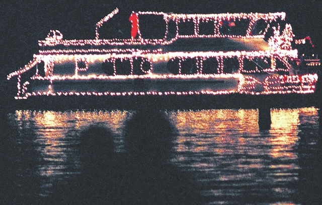 Las Vegas Review-Journal File photo A couple watches the Parade of Lights from Boulder Beach.