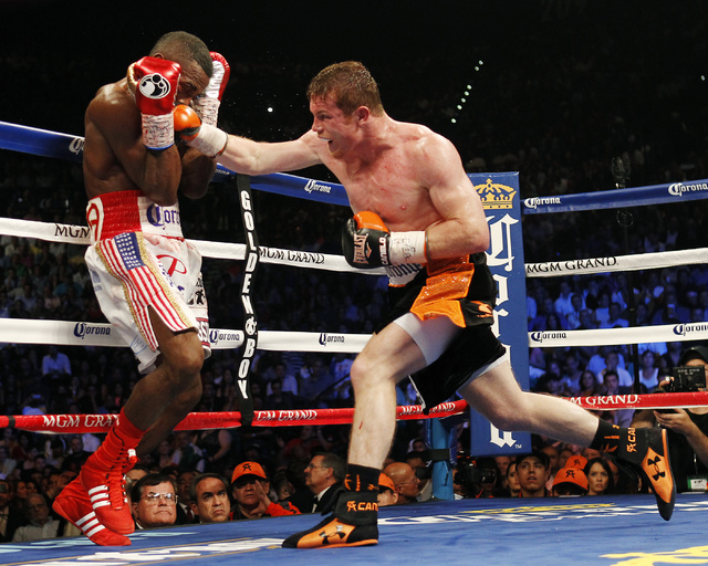"""Saul """"Canelo"""" Alvarez fought twice in Las Vegas this year. Alvarez, right, hits Erislandy Lara during their Super Welterweight fight at the MGM Grand Garden Arena on July 12, 2014. He also beat Al ..."""