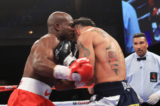 Diego Chaves accidentally head butts Timothy Bradley during their fight Saturday, Dec. 13, 2015 at the Cosmopolitan. After 12 rounds, the fight ended in a draw. (Sam Morris/Las Vegas Review-Journal)