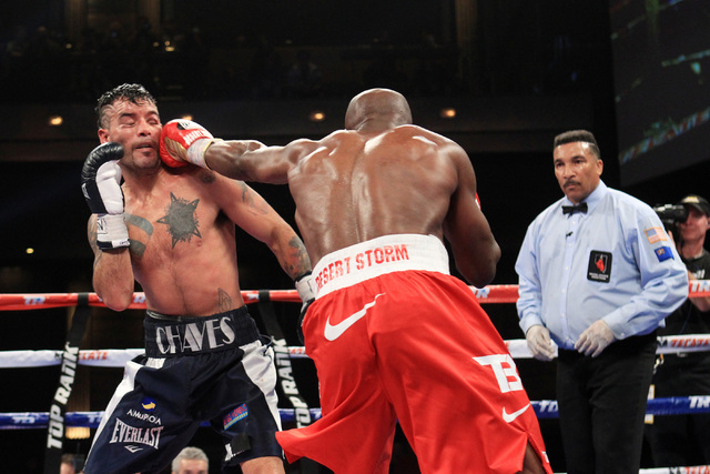 Diego Chaves gets hit with a left from Timothy Bradley during their fight Saturday, Dec. 13, 2015 at the Cosmopolitan. After 12 rounds, the fight ended in a draw. (Sam Morris/Las Vegas Review-Journal)