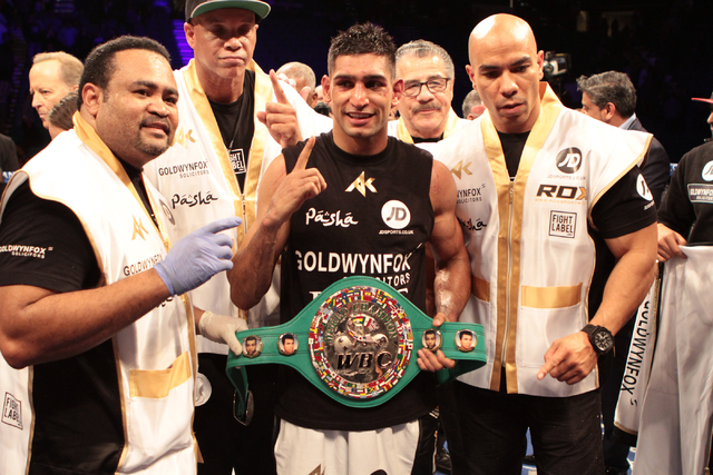 Amir Khan poses after winning the WBC Silver welterweight fight against Devon Alexander at the MGM Grand Garden in Las Vegas, Friday, Dec. 13, 2014. (Donavon Lockett/Las Vegas Review-Journal)