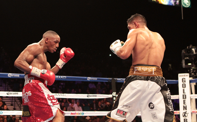 Devon Alexander, left prepares to throw a punch at Amir Khan during their title bout for the WBC Silver welterweight fight at the MGM Grand Garden in Las Vegas, Friday, Dec. 13, 2014. (Donavon Loc ...