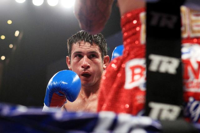 Mauricio Herrera forces Jose Benavidez to the ropes during their fight Saturday, Dec. 13, 2015 at the Cosmopolitan. (Sam Morris/Las Vegas Review-Journal)
