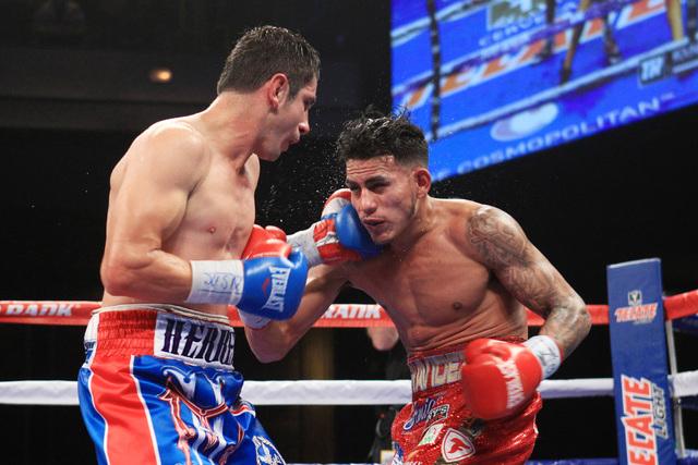Mauricio Herrera tags Jose Benavidez with a left during their fight Saturday, Dec. 13, 2015 at the Cosmopolitan. (Sam Morris/Las Vegas Review-Journal)