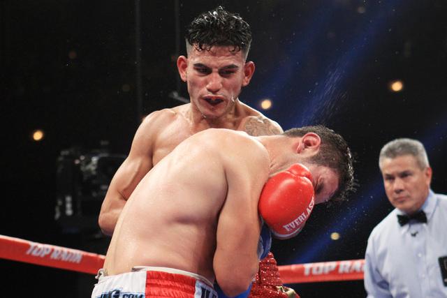 Jose Benavidez hits Mauricio Herrera with a left during their fight Saturday, Dec. 13, 2015 at the Cosmopolitan. (Sam Morris/Las Vegas Review-Journal)