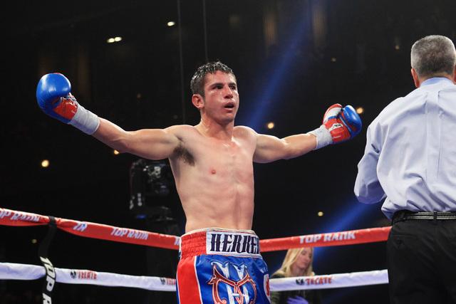 Mauricio Herrera raises his arms after his fight with Jose Benavidez Saturday, Dec. 13, 2015 at the Cosmopolitan. (Sam Morris/Las Vegas Review-Journal)