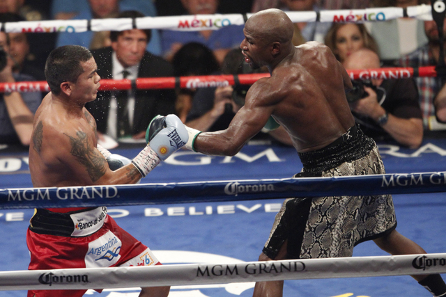 Floyd Mayweather Jr., right, connects a punch against Marcos Maidana during their WBC/WBA welterweight title fight at the MGM Grand Garden Arena in Las Vegas on Sept. 13, 2014. Mayweather Jr. won  ...