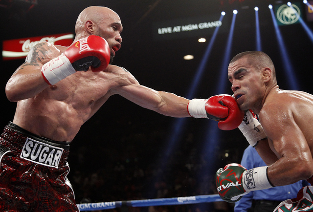 Ishe Smith hits Carlos Molina during their IBF Junior Middleweight title bout at the MGM Grand in Las Vegas Saturday, Sept. 14, 2013. (John Locher/Las Vegas Review-Journal)