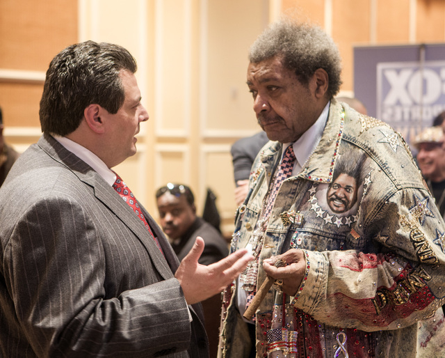 WBC president Mauricio Sulaiman,left, talks to boxing promoter Don King during the WBC 52nd convention in the Events Center at The Mirage hotel-casino on Monday, Dec. 15, 2014. Sulaiman was appoin ...