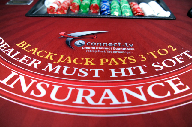 A blackjack table is seen in eConnect's Las Vegas office on Monday, Nov. 24, 2014. The company developed software that allows it customers to analyze customer behavior and employee practices to im ...