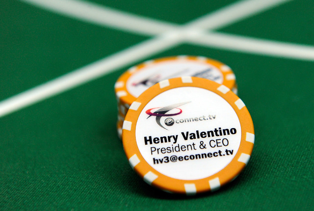 """eConnect President and CEO Henry Valentino business """"chip"""" is displayed on baccarat table in his Las Vegas office on Monday, Nov. 24, 2014. Valentino developed software that allows companies to an ..."""