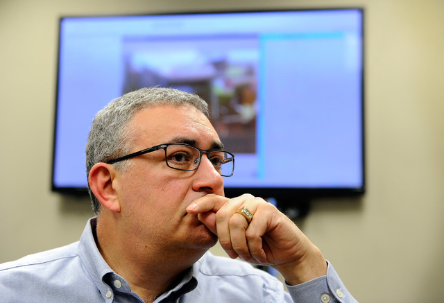 eConnect President and CEO Henry Valentino looks on in his Las Vegas office on Monday, Nov. 24, 2014. Valentino developed software that allows companies to analyze customer behavior and employee p ...