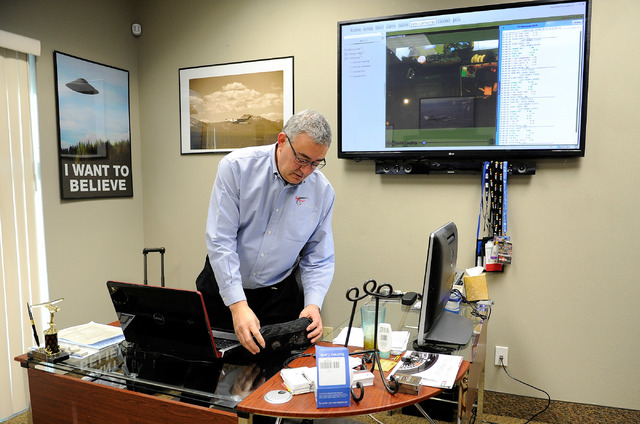 eConnect President and CEO Henry Valentino works in his Las Vegas office on Monday, Nov. 24, 2014. Valentino developed software that allows companies to analyze customer behavior and employee prac ...